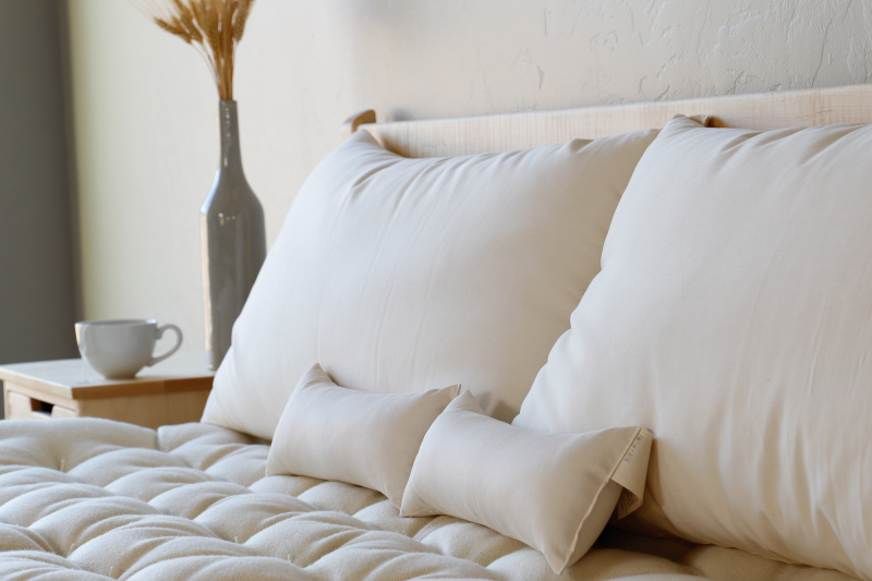 Wool Pillows with Neck Rolls in Natural Light