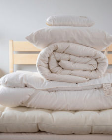 Photo of twin wool surround on wool bed: twin topper, twin comforter, standard pillow, and free neck roll.