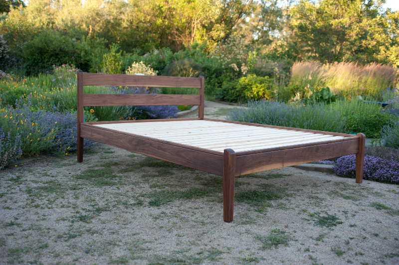 Angled view of walnut Century frame outdoors