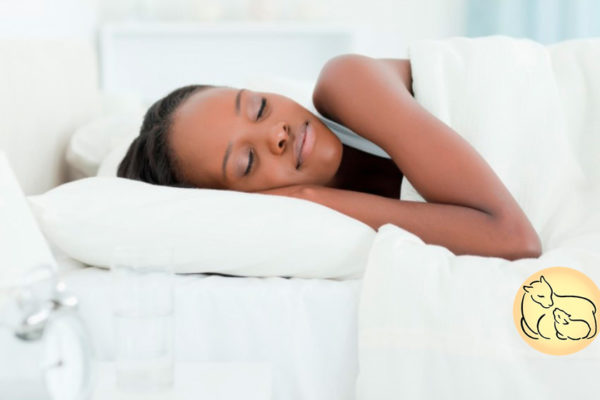 woman sleeping peacefully on wool mattress topper