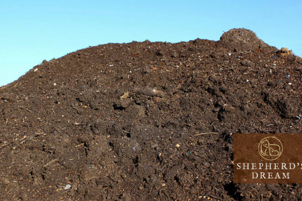 climate beneficial wool: composting pile on a farm